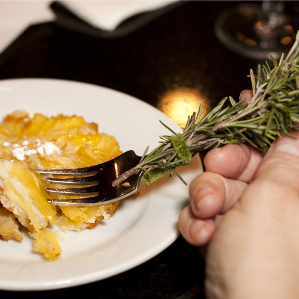 A bite of tart with a rosemary laced fork