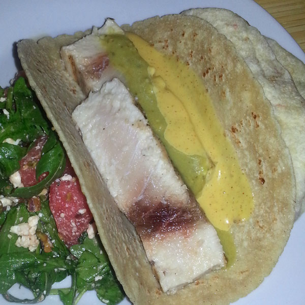 Swordfish taco with two sauces and a side of arugula-watermelon salad
