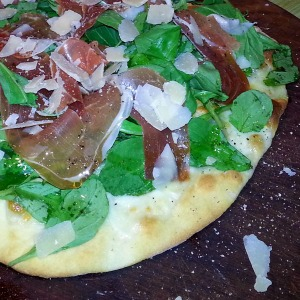 Arugula and prosciutto pizza with shaved parm