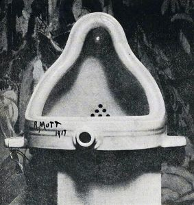 """Urinal """"readymade"""" signed with joke name; early example of """"Dada"""" art. A paradigmatic example of found-art. Photograph by Alfred Stieglitz. Captions read: """"Fountain by R. Mutt, Photograph by Alfred Stieglitz, THE EXHIBIT REFUSED BY THE INDEPENDENTS"""""""