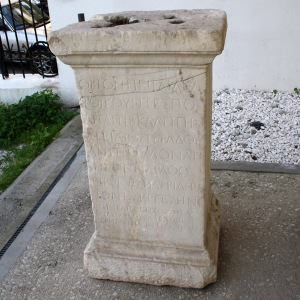 Base for a Roman Age statue of Bradua (son of Herodes Atticus). 2nd century AD. On display at the open-air exhibition along the Ancient Greek theater in the Archaeological Museum of Piraeus (Athens). Picture by Giovanni Dall'Orto, November 14 2009, via Wikimedia Commons