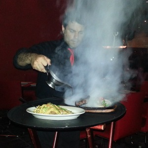Steam rising from griddled steak at Silk
