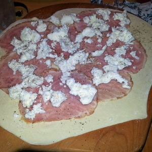 Add ham, fresh mozzarella and cracked pepper