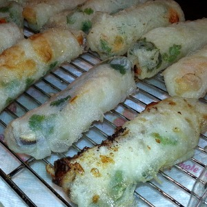 Spring rolls cooling on a rack