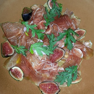 Prosciutto & fig on brown plate
