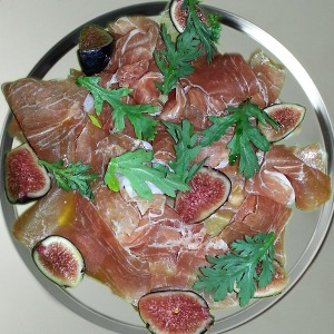 Prosciutto & fig on stainless steel charger