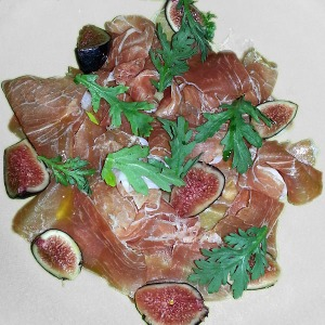 Prosciutto & fig on white plate