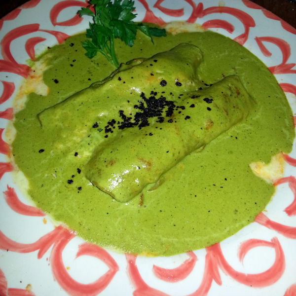 Enchiladas de pato (Enchiladas with shredded duck topped with a poblano-spinach sauce) from La Fonda San Miguel